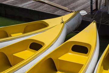 Yellow boats moored at wooden pier on the lake.