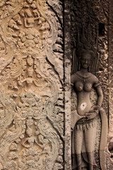 Motives, patterns and Buddha carvings on the ancient walls of Angkor Wat Temple, near Siem Reap, Cambodia, Asia. Buddhist monastery from the 12th century. Asian architectural close up.