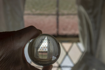 Stained glass window with curtains in crystal ball