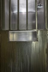 Metal door on shower stall in prison