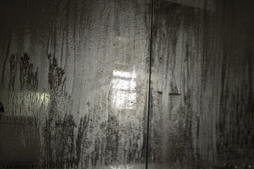 Condensation on mirror with reflection of light through window
