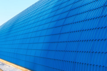 Perspective of the hangar wall from blue tile