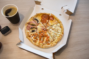 Pizza slices with salami and mushrooms, coffee, drinks.