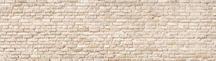 Beige old brick wall panorama. Wall mural