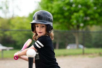 Girl swinging a bat