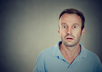 Stunned man with eyes wide opened