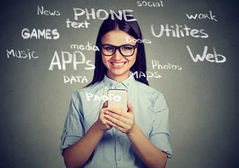 Pretty woman communicating via smartphone