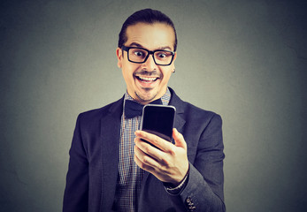 Excited man reading news on smartphone
