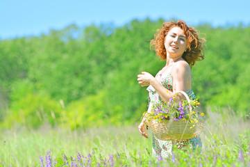 Beautiful girl feels freedom on a green summer lawn