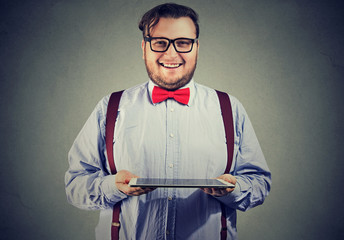 Cheerful man showing new tablet