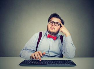 Thoughtful man remembering password