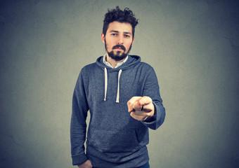 Serious man pointing at camera