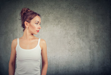 Skinny girl with makeup looking side way