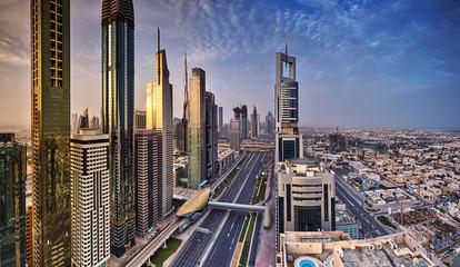 Dubai skyline during sunrise, Sheikh Zayed road traffic,United Arab Emirates.