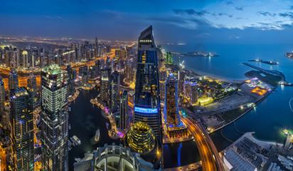 Bird´s eye view of Dubai marina skyscrapers during sunset.