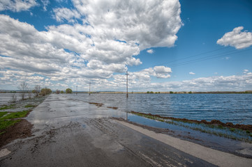 The flood of the river Don. Dangerous water level on the road towards Tryokhostrovskaya ferry station.