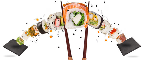 Pieces of delicious japanese sushi frozen in the air. Wall mural