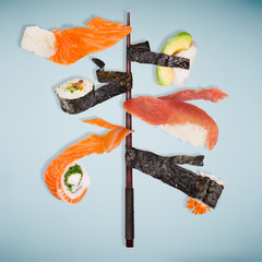 Pieces of delicious japanese sushi frozen in the air.