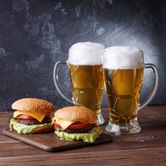 Picture of two hamburgers, glasses with beer