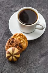 Cup of coffee and sweet cookies.