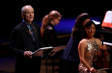 Actor Bill Murray recites his words during a performance with cellist Jan Vogler from their new album New Worlds, at the Southbank Centre in London