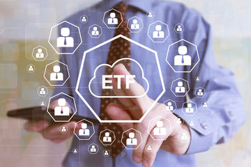 Financier pressing button etf Exchange Traded Fund on a virtual interface icon