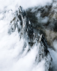 Aerial of a mountain range clouded in fog in Switzerland