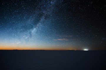 Salar de Uyuni salt flat at starry night before moon rise. Altiplano, Bolivia