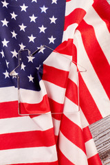 Flag of USA and metal house shaped form. House pastry cutter shape and USA flag background, vertical image.