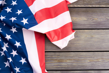 American flag and text space. USA patriotic flag on wooden background and copy space. Memorial Day concept.