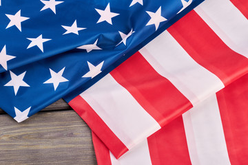 Close up American flag on wooden background. USA patriotic flag folded on wooden surface.