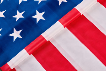 American flag background. Close up folded satin flag of the USA. Happy Independence Day. Idea for banner.
