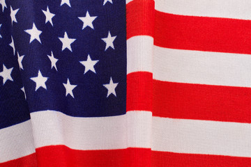 Cotton flag of USA background. American flag fabric close up. USA flag wallpaper.