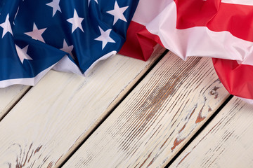 Happy Independence Day background. USA flag on wooden background and copy space, horizontal image.