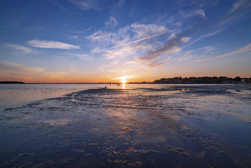 Vibrant sunset against a sunny sky over Poole Harbour in Dorset, UK