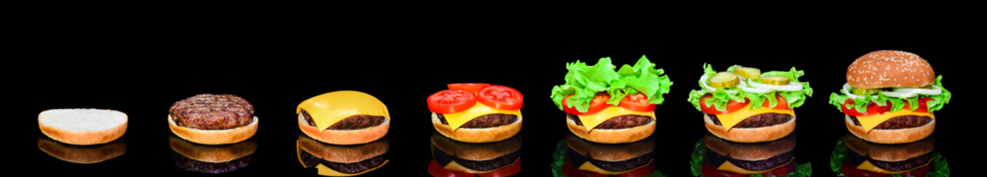 Process making of burger, step by step isolated on black background. Burger wide banner. Split burger. Burger divided in parts