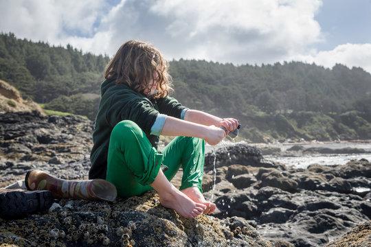 Young Girl Beach Combing