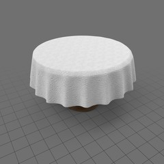 Round dining table with tablecloth