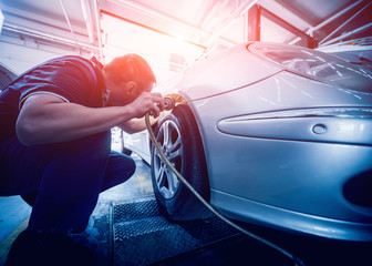 Automotive suspension test and brake test rolls in a auto repair service.