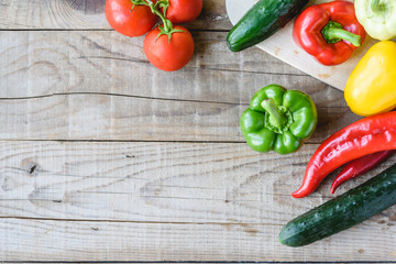 Selection of colorful vegetable on wooden table. Cooking fresh food background.
