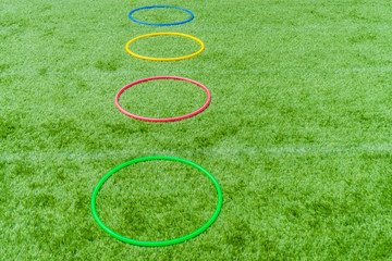 Colored hula hoops on grass