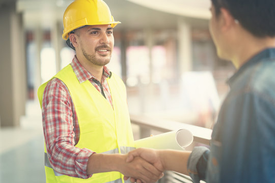 Engineer worker shaking hand with customer or co worker in the office