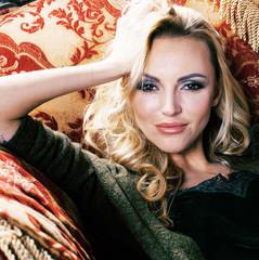 young pretty woman waiting alone in modern loft studio, fashion