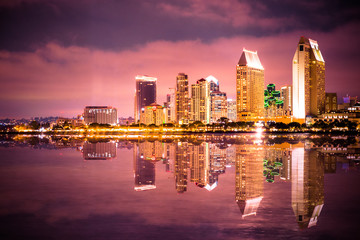Wall Mural - Beautiful night skyline of San Diego California with bay of water and lit buildings