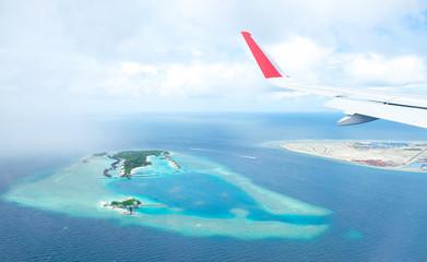 Maldives island atoll, vacation paradise sea, aerial view from airplane