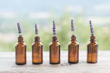 Lavender bottle natural rustic background. Ayurveda Alternative Medicine Spa Wellness Herbal Health Wellbeing Aromatic Aromatherapy Phytotherapy Homeopathy Pharmacy Body Care Relaxation Beauty Concept