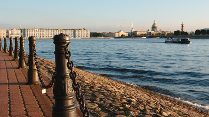 Iron columns on an embankment of the Neva river in the summer - St. Petersburg, Russia