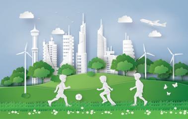 boy plaing football in the city park