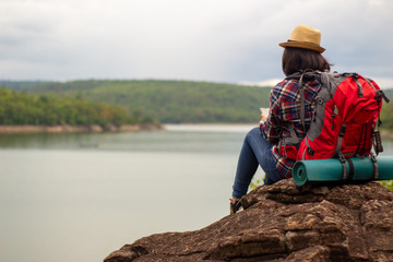 Young woman watching and Take a photo landscape,.backpacker.