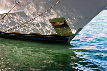 closeup of ship and reflection in water